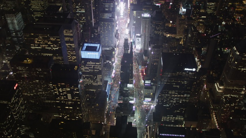 4K stock footage aerial video Tilting up to reveal Times Square, Midtown Manhattan, New York, New York, night Aerial Stock Footage | AX85_043