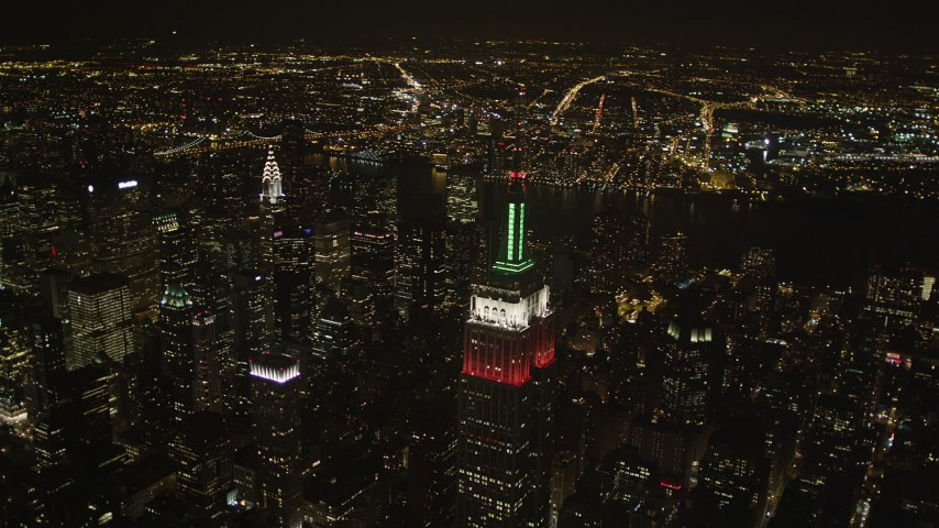 4K stock footage aerial video Flying by Empire State Building, Midtown Manhattan, New York, New York, night Aerial Stock Footage   AX85_047