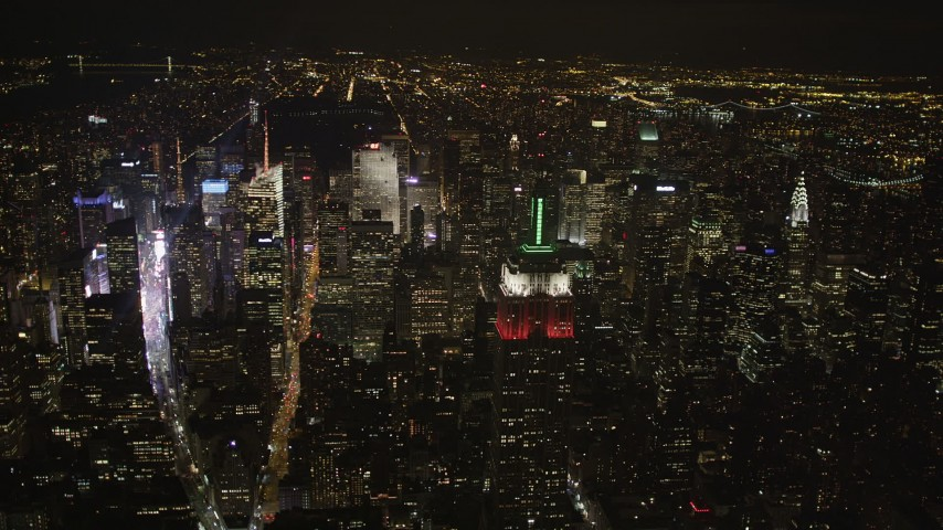 4K stock footage aerial video Empire State Building, Midtown Manhattan, Times Square, New York, night Aerial Stock Footage | AX85_048