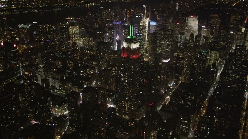 4K aerial video Reveal Empire State Building, Midtown Manhattan, New York, New York, night Aerial Stock Footage   AX85_049