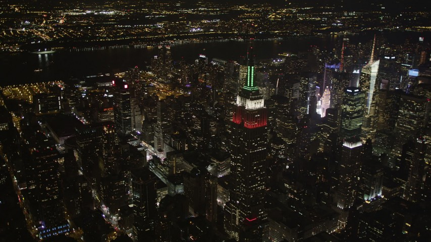 4K stock footage aerial video Flying by Empire State Building, Midtown Manhattan, New York, New York, night Aerial Stock Footage | AX85_050