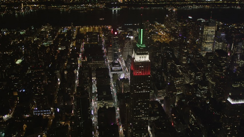 4K stock footage aerial video Flying by the Empire State Building, Midtown Manhattan, New York, New York, night Aerial Stock Footage | AX85_051