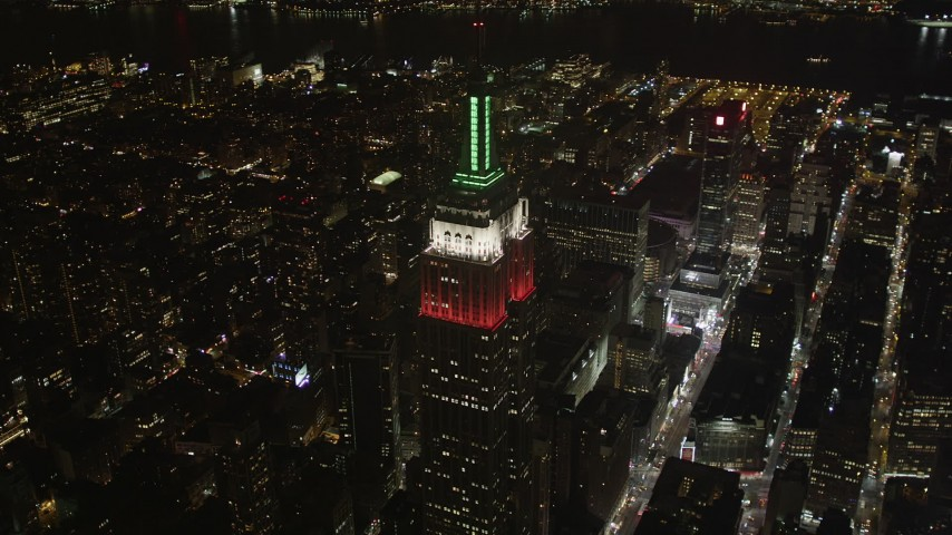 4K stock footage aerial video Flying by the Empire State Building, Midtown Manhattan, New York, New York, night Aerial Stock Footage | AX85_052