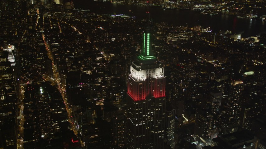 4K stock footage aerial video Flying by the Empire State Building, Midtown Manhattan, New York, New York, night Aerial Stock Footage | AX85_053