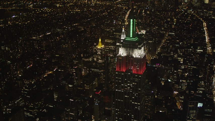 4K stock footage aerial video Top of the Empire State Building, Midtown Manhattan, New York, New York, night Aerial Stock Footage | AX85_054