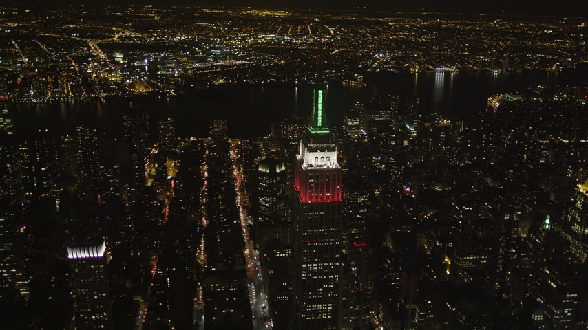 4K stock footage aerial video Empire State Building, Chrysler Building, Midtown Manhattan, New York, night Aerial Stock Footage | AX85_055