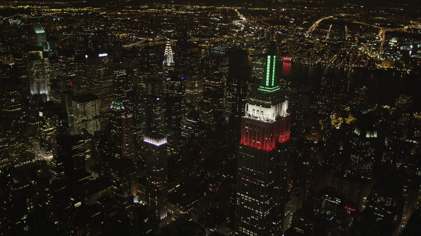 4K stock footage aerial video Flying by Empire State Building, Midtown Manhattan; New York, New York, night Aerial Stock Footage | AX85_056