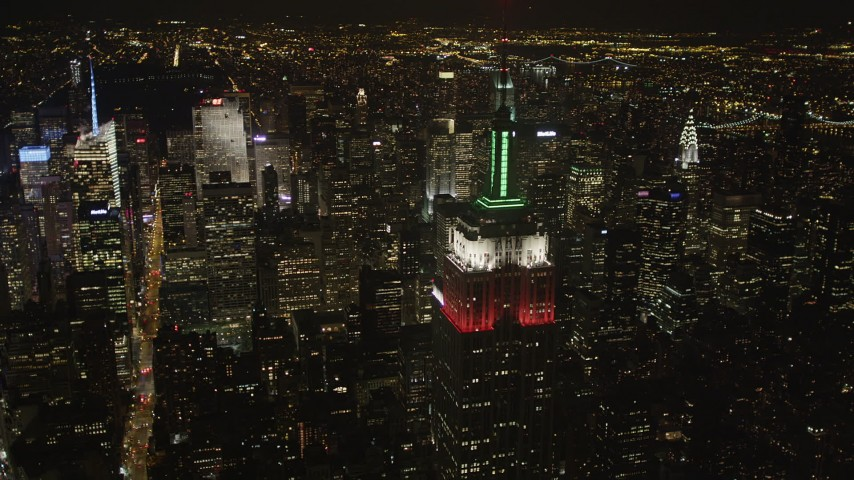 4K stock footage aerial video Flying by Empire State Building, revealing Times Square, New York, New York, night Aerial Stock Footage | AX85_057