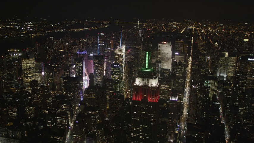 5k aerial video Flying by Empire State Building, Midtown Manhattan, New York, New York, night Aerial Stock Footage | AX85_058