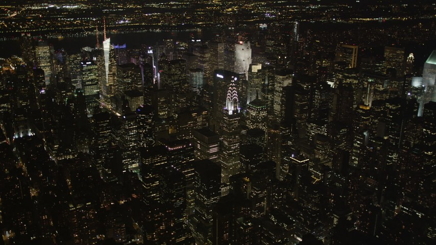 4K stock footage aerial video Tilt up revealing Chrysler Building, Midtown Manhattan, New York, New York, night Aerial Stock Footage | AX85_061