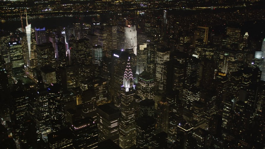 4K stock footage aerial video Approaching Chrysler Building, Midtown Manhattan, New York, New York, night Aerial Stock Footage | AX85_062