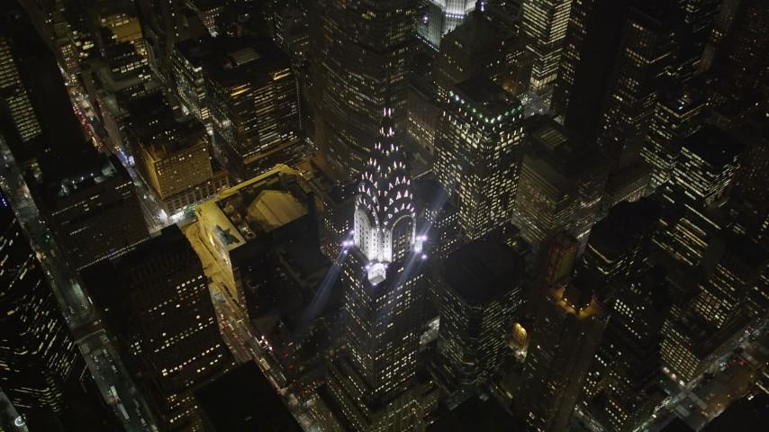 4K stock footage aerial video Bird's eye view of Chrysler Building, Midtown Manhattan, New York, New York, night Aerial Stock Footage | AX85_063