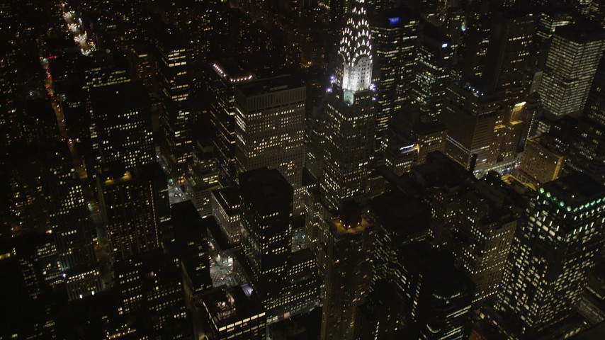 5k aerial video Tilt up to reveal Chrysler Building, Midtown Manhattan, New York, New York, night Aerial Stock Footage | AX85_067
