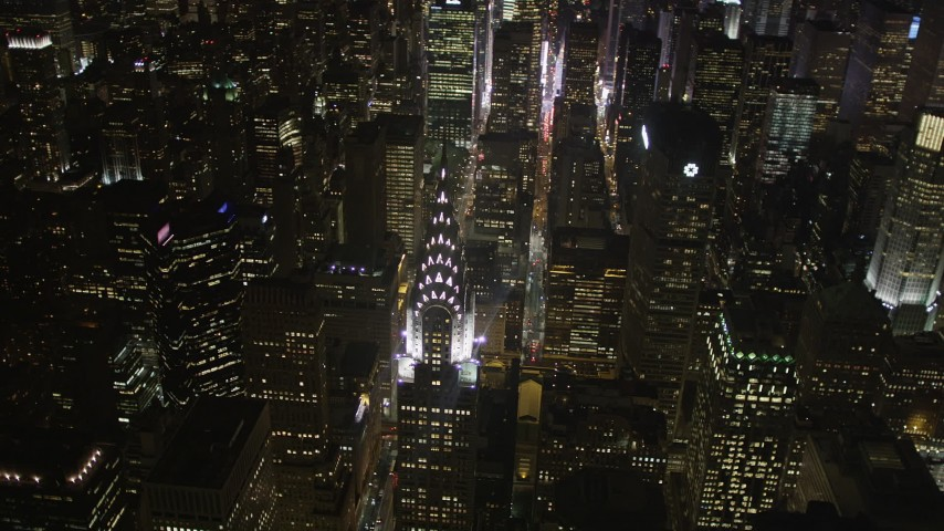 4K stock footage aerial video Flying by Chrysler Building, Midtown Manhattan, New York, New York, night Aerial Stock Footage | AX85_068