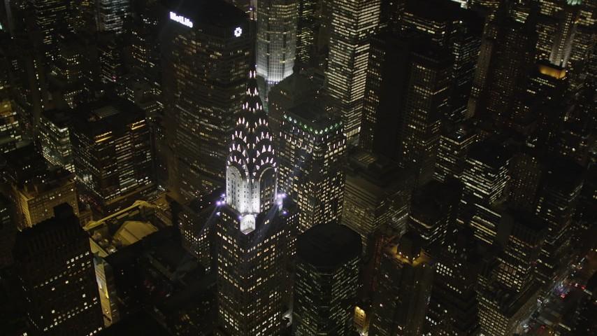 5k aerial video Flying by Chrysler Building, Midtown Manhattan, New York, New York, night Aerial Stock Footage | AX85_069