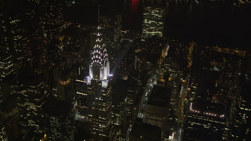 4K stock footage aerial video Flying by Chrysler Building, Midtown Manhattan, New York, New York, night Aerial Stock Footage | AX85_071