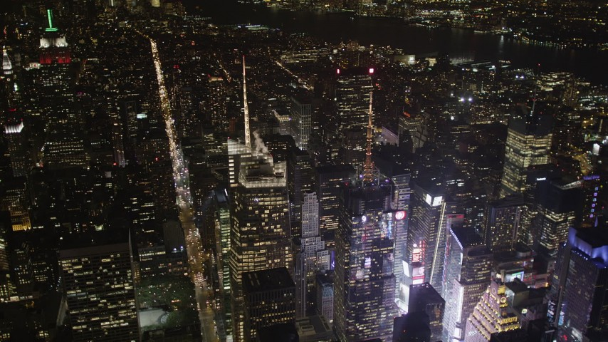 4K stock footage aerial video Bank of America Tower, Times Square, Midtown Manhattan, New York, night Aerial Stock Footage | AX85_072
