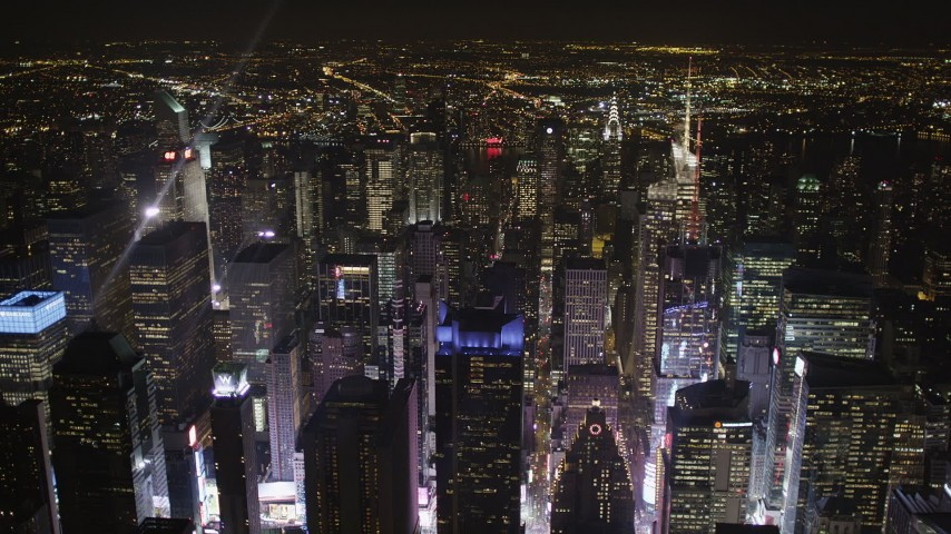5k aerial video Times Square skyscrapers, Midtown Manhattan, New York, New York, night Aerial Stock Footage | AX85_075