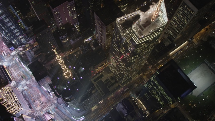 4K stock footage aerial video Bank of America Tower, city streets, Midtown Manhattan, New York, New York, night Aerial Stock Footage | AX85_078