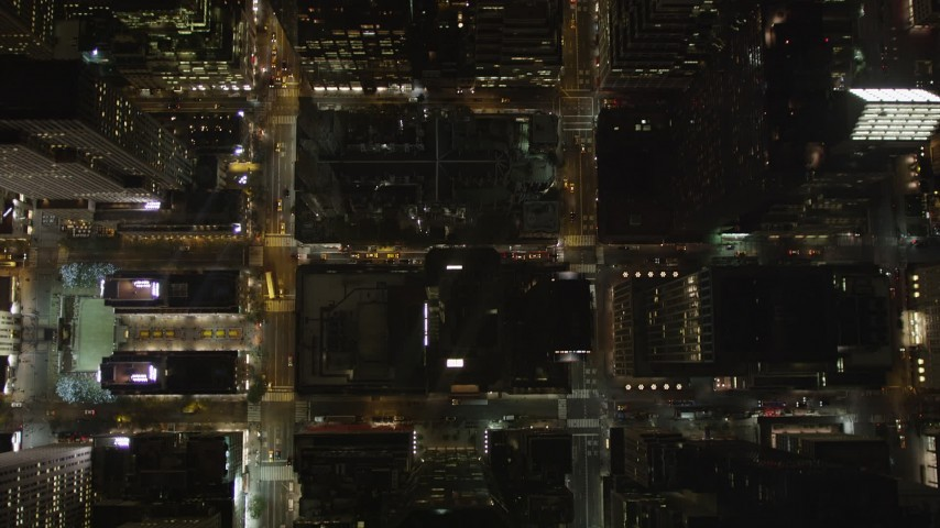 4K aerial video Bird's eye view flying over Midtown Manhattan streets, New York, New York, night Aerial Stock Footage | AX85_079