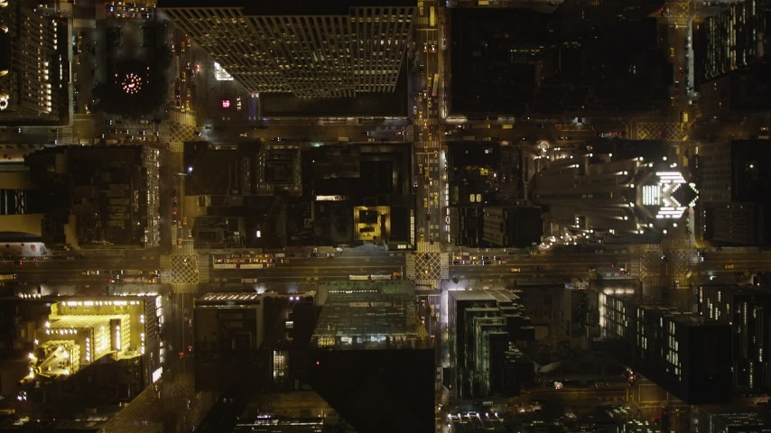 4K aerial video Flying over streets, skyscrapers, Midtown Manhattan, New York, New York, night Aerial Stock Footage | AX85_080