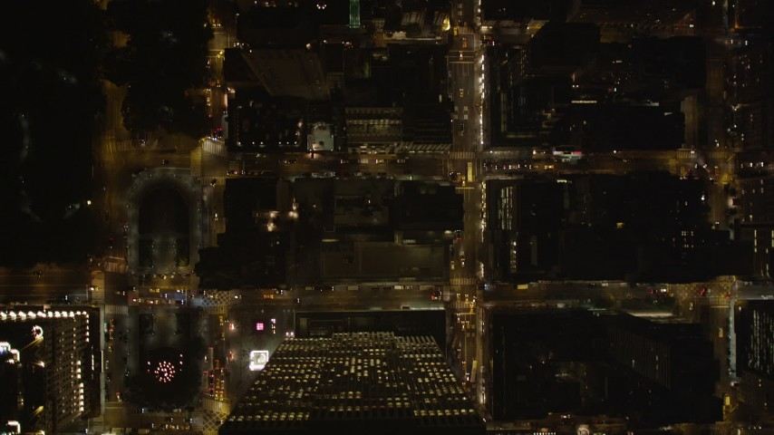 4K stock footage aerial video Bird's eye view over city streets, Midtown Manhattan, New York, New York, night Aerial Stock Footage | AX85_081