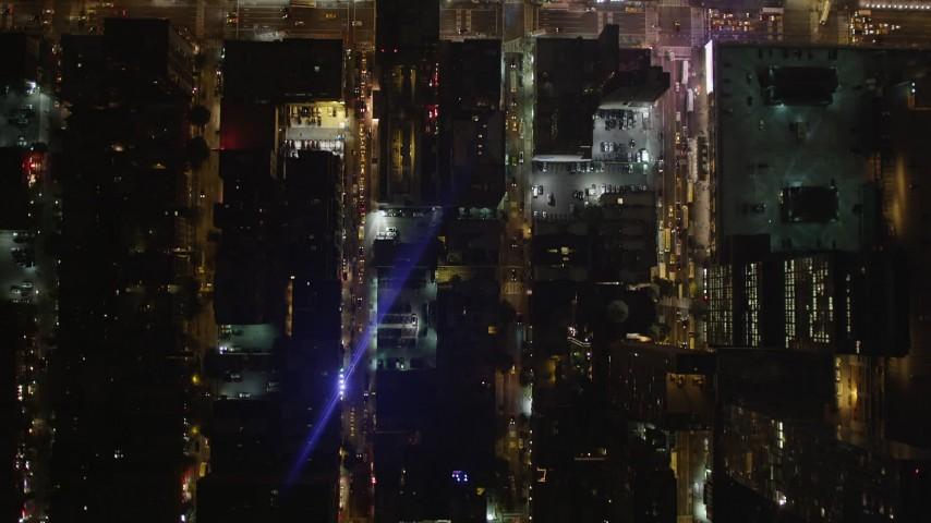 4K stock footage aerial video Bird's eye view over city streets, Midtown Manhattan, New York, New York, night Aerial Stock Footage | AX85_094