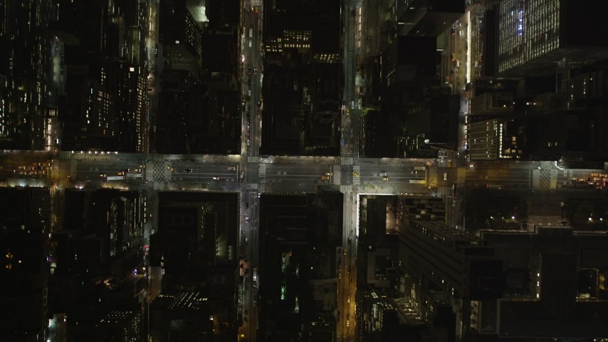 5k aerial video Bird's eye view over city streets, Midtown Manhattan, New York, New York, night Aerial Stock Footage | AX85_097