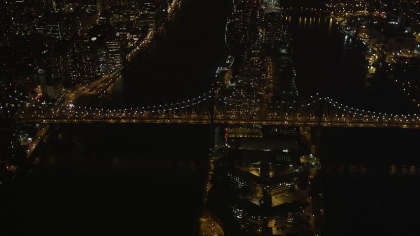 4K aerial video Approaching the Queensboro Bridge, tilt down, New York, New York, night Aerial Stock Footage | AX85_100