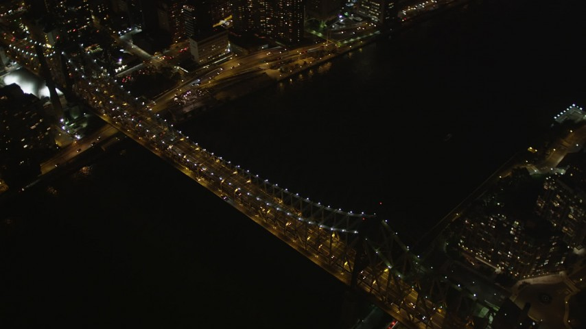 4K stock footage aerial video Fly by Queensboro Bridge, reveal Midtown Manhattan, New York, New York, night Aerial Stock Footage | AX85_101