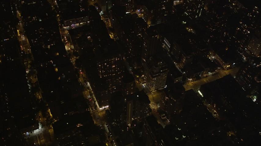4K stock footage aerial video Pan across Upper East Side, reveal Midtown Manhattan, New York, New York, night Aerial Stock Footage | AX85_103