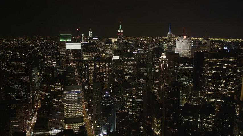 4K stock footage aerial video Flying by Midtown Manhattan skyscrapers, New York, New York, night Aerial Stock Footage | AX85_104