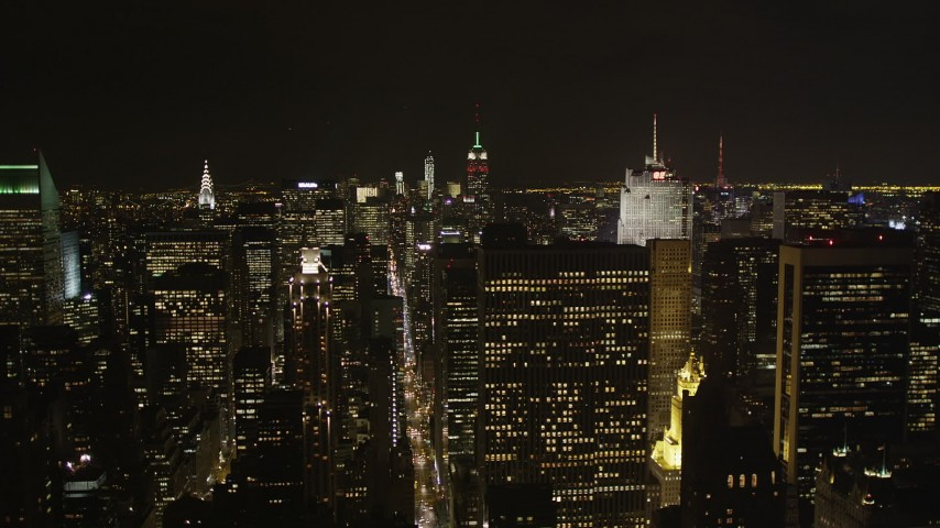 4K stock footage aerial video Flying by Midtown Manhattan skyscrapers, New York, New York, night Aerial Stock Footage   AX85_105