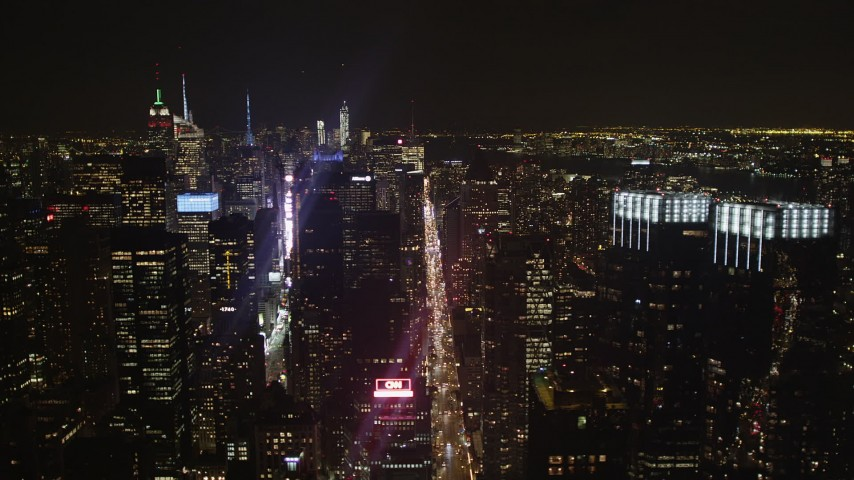 4K aerial video Fly by Times Square, skyscrapers, Midtown Manhattan, New York, New York, night Aerial Stock Footage | AX85_107