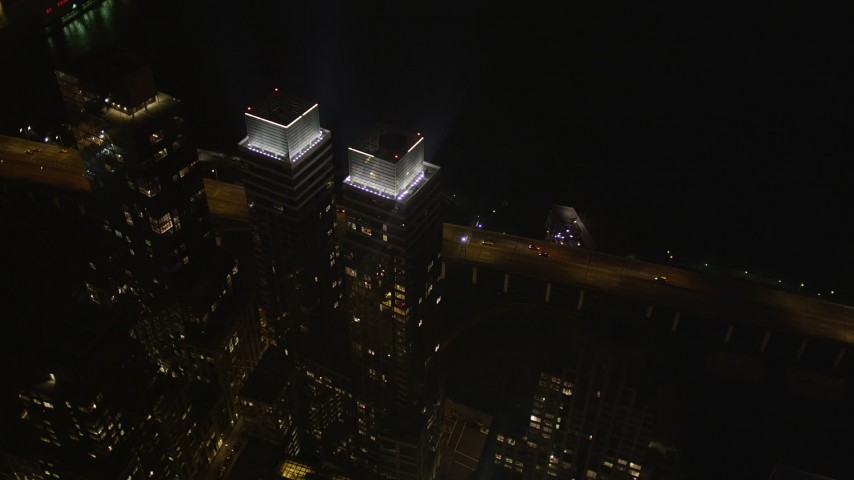 4K stock footage aerial video Approach skyscrapers, Hudson River, Midtown Manhattan, New York, night Aerial Stock Footage | AX85_108