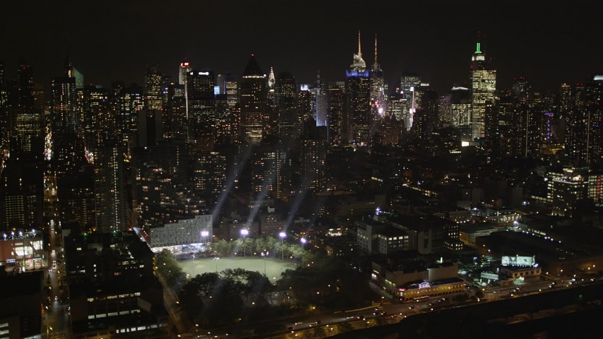 4K stock footage aerial video Flying by Midtown Manhattan, seen from Hudson River, New York, New York, night Aerial Stock Footage | AX85_110