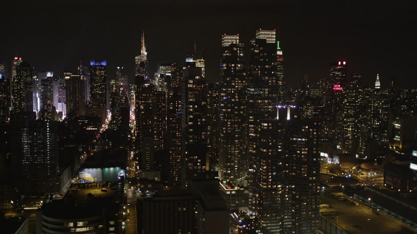 4K stock footage aerial video Flying by Midtown Manhattan, seen from Hudson River, New York, New York, night Aerial Stock Footage | AX85_112