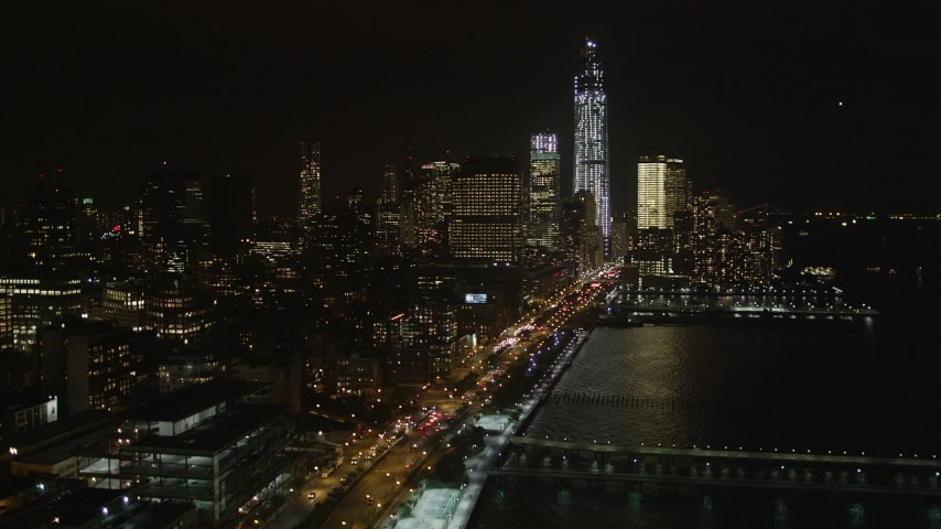 4K aerial video Approaching Lower Manhattan from Chelsea, New York, New York, night Aerial Stock Footage | AX85_118