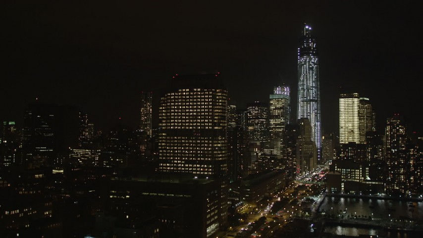 4K stock footage aerial video Approaching One World Trade Center, Lower Manhattan, New York, New York, night Aerial Stock Footage | AX85_119