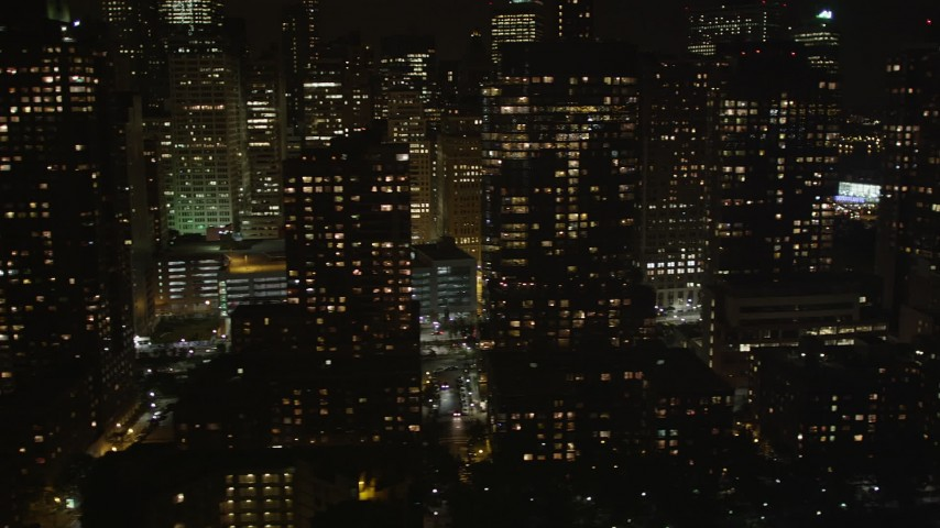 Flying by Lower Manhattan skyscrapers, New York, New York, night Aerial Stock Footage | AX85_123