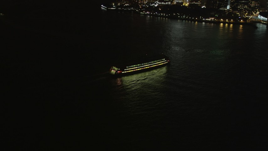 4K stock footage aerial video Fly by Staten Island Ferry, reveal Lower Manhattan, New York, New York, night Aerial Stock Footage | AX85_125