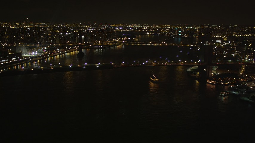 4K stock footage aerial video Approaching Brooklyn Bridge, New York, New York, night Aerial Stock Footage | AX85_127
