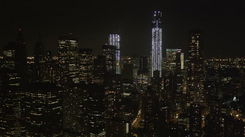 4K stock footage aerial video Tilt to reveal One World Trade Center, Lower Manhattan, New York, New York, night Aerial Stock Footage | AX85_129
