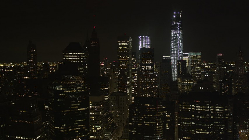 4K stock footage aerial video Fly by One World Trade Center, Lower Manhattan, New York, New York, night Aerial Stock Footage | AX85_130