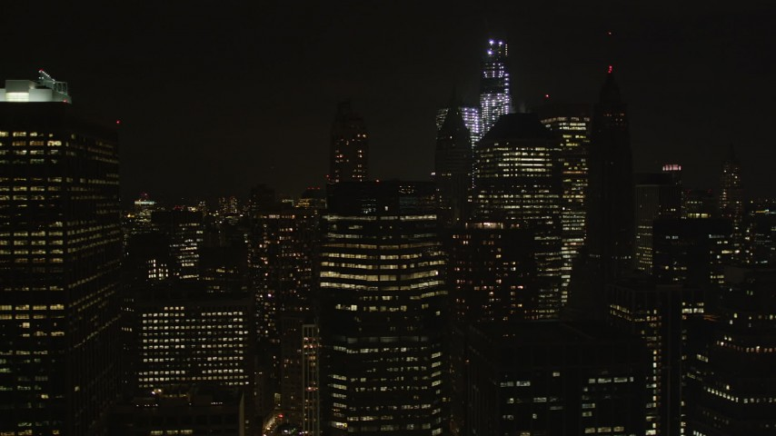 4K aerial video Flying by Lower Manhattan skyscrapers, New York, New York, night Aerial Stock Footage | AX85_131