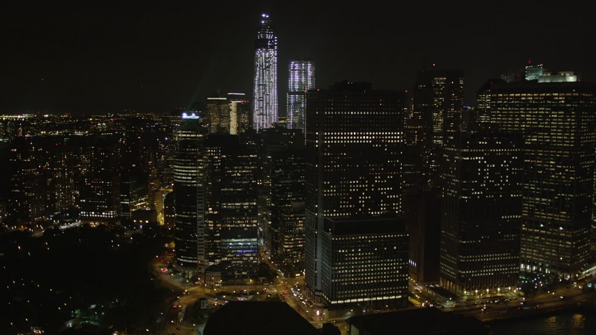 4K stock footage aerial video Flying away from Lower Manhattan skyscrapers, New York, New York, night Aerial Stock Footage | AX85_132