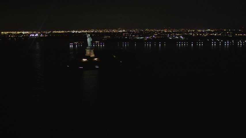 4K stock footage aerial video Approaching the Statue of Liberty, New York, New York, night Aerial Stock Footage | AX85_134