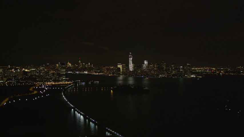 4K aerial video Flying away from Lower Manhattan skyline, New York, New York, night Aerial Stock Footage | AX85_136