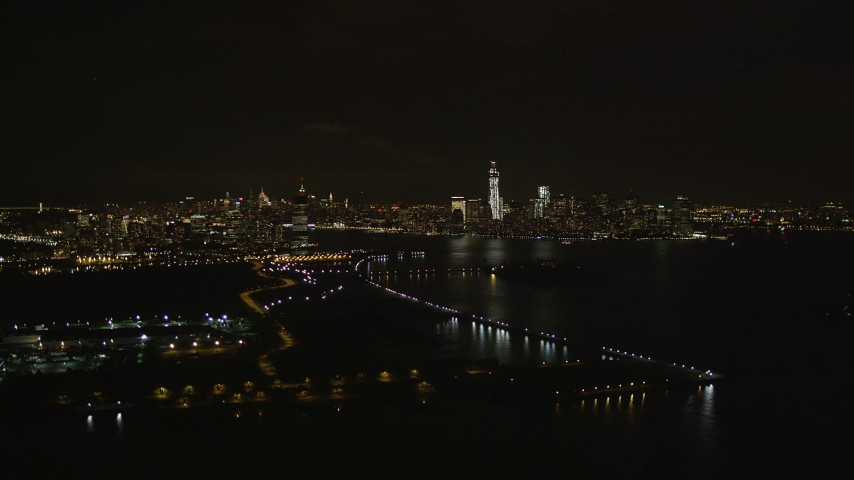 4K stock footage aerial video Flying away from Lower Manhattan skyline, New York, New York, night Aerial Stock Footage | AX85_137