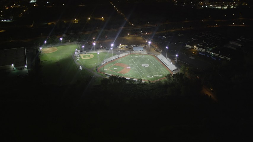 5k aerial video Flying by a baseball field, Jersey City, New Jersey, night Aerial Stock Footage | AX85_138